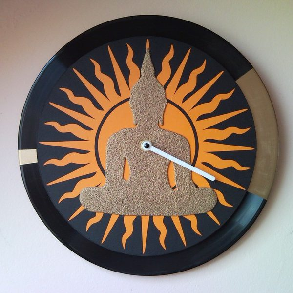 Gold Buddha wall clock from vinyl LP with sun motive
