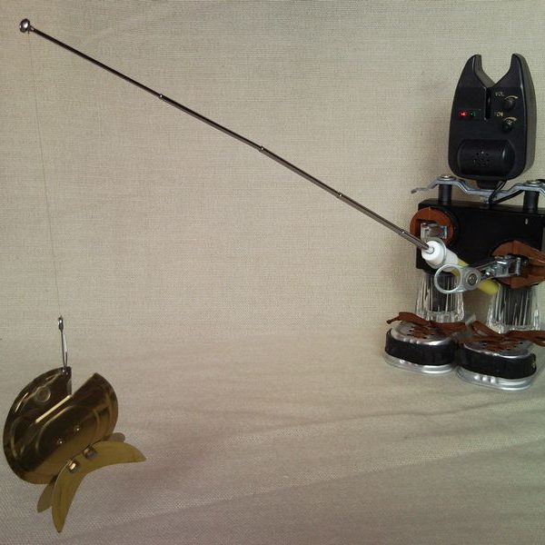 Fisherman catch the goldfish, upcycled sculpture from bite indicator