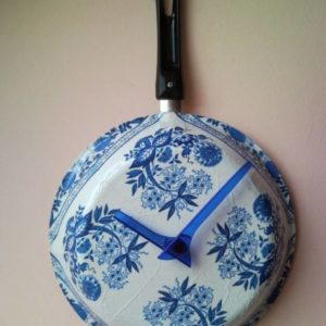 Upcycled wall clock from griddle, frying pan with decoupaged flowers 1.