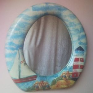 Upcycled toilet seat wall mirror with decoupage lighthouse and sailing boat
