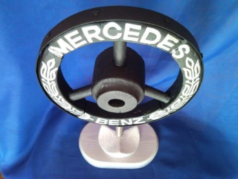 Mercedes Benz car brand emblem, sign, logo from old wooden wheel