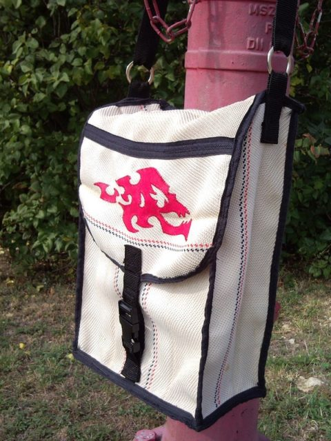 Unisex flaming skull shoulder bag from recycled fire hose