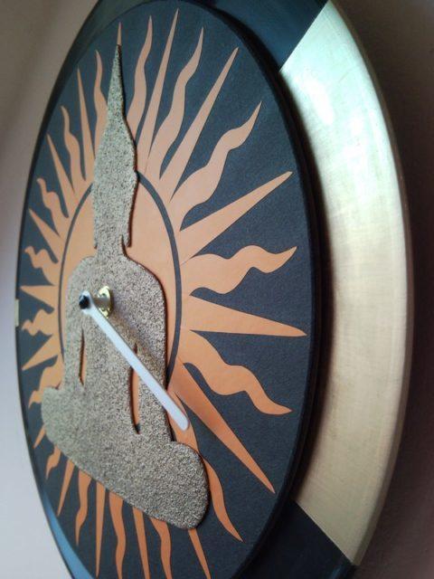 Gold Buddha wall clock from vinyl LP with sun motive