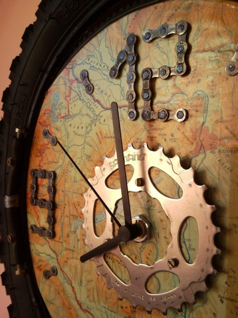Recycled bicycle wheel wall clock with map for bikers