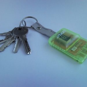 PlayStation keychain from recycled memory card and plug