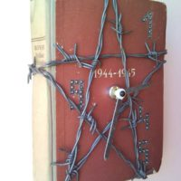 Barbed wire star wall clock from warlike historical book