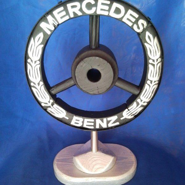 Mercedes Benz car brand emblem, sign, logo from old wooden wheel