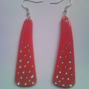 Pink earrings from temple of sunglasses