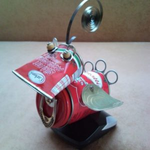 Recycled tomato red Bird of Paradise sits in phone charger nest