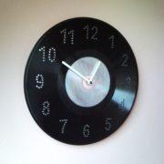 Disc jockey wall clock from vinyl LP record and CD, DVD