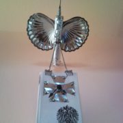 Metal sculpture eagle wall clock with iron cross book