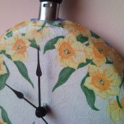 Upcycled wall clock from griddle, frying pan with decoupaged flowers 3.
