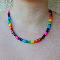 Rainbow colored pencil crayon necklace on transparent elastic fishing line 1