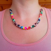 Rainbow colored crayon pencil necklace on transparent elastic fishing line 2